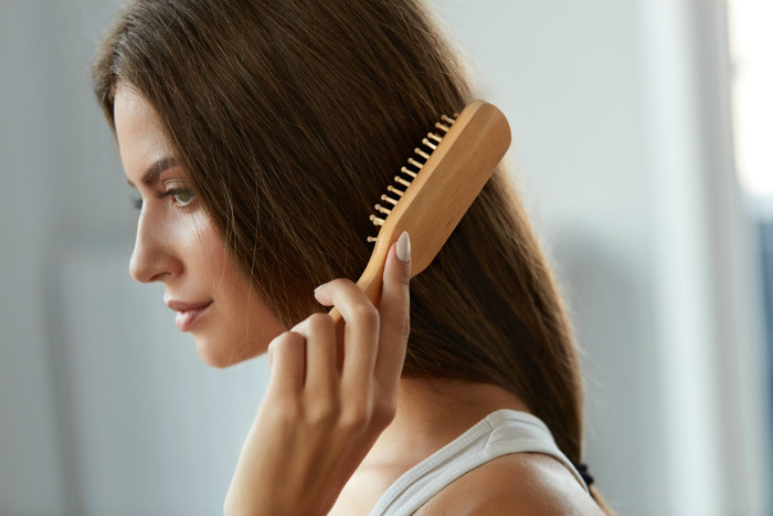 Girl using Wide-Tooth Tail Combs