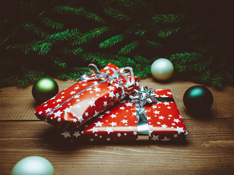 two gifts on table with Christmas tree