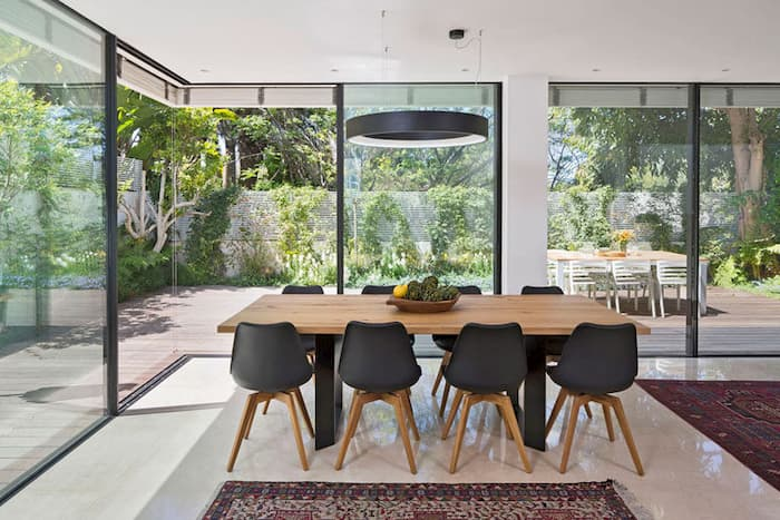 dining table and black metal lighting