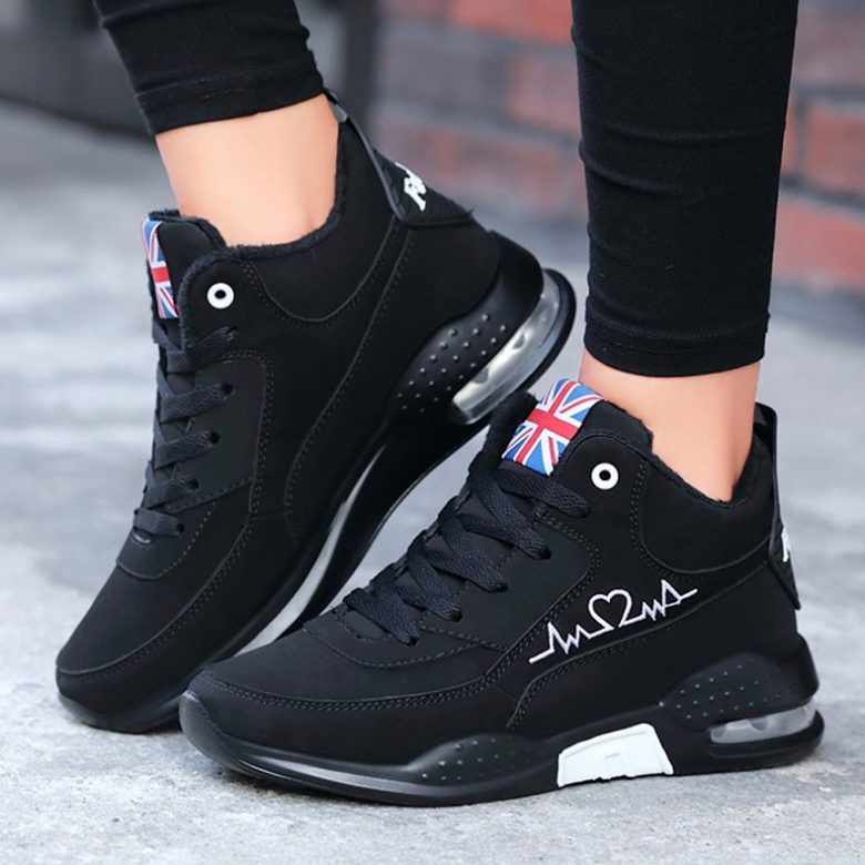 picture of women wearing black high top  sneakers on the street
