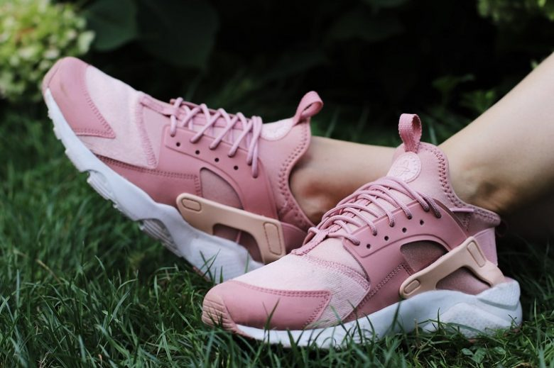 picture of girl on the grass wearing pink mixed material sneakers