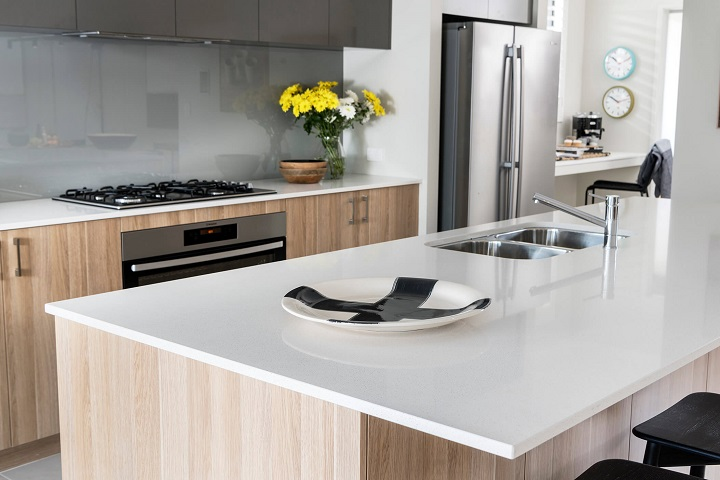 picture of a modern kitchen with stainless steel sink and tap ware