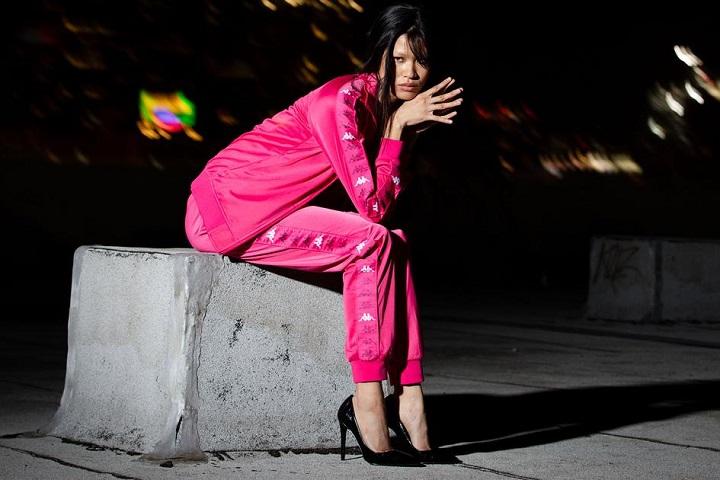girl wearing pink kappa tracksuits