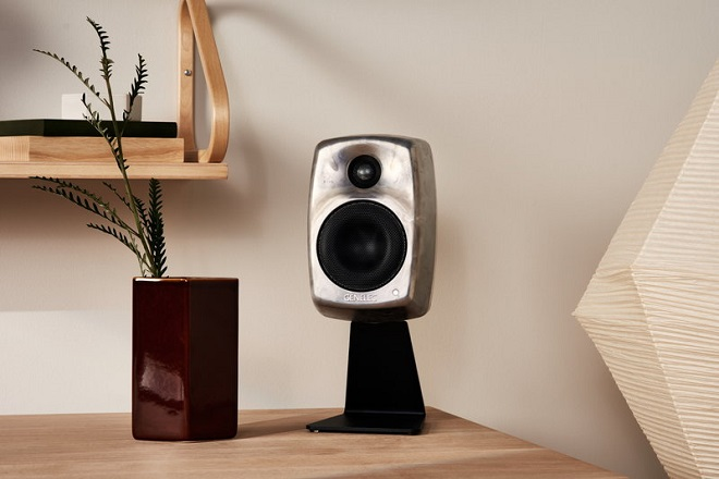 close up of speaker on wooden table